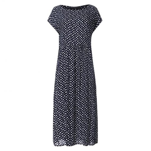 look robe a pois noire dolce vita