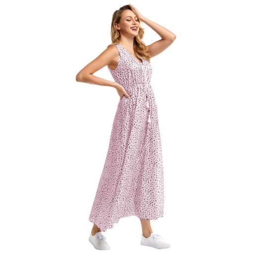 robe longue a pois avec une rose derriere